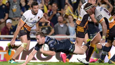 Breakthrough: Michael Morgan scores for the Cowboys in Townsville.