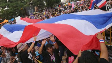 Anti-government protesters move a giant national flag during a rally in Bangkok, Thailand.