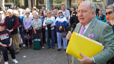 Alan Jones speaks at an anti-Clover Moore rally in August.