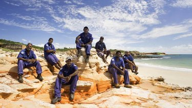 Looking after the land: A group of indigenous rangers take a break. About 680 rangers are employed on more than 50 indigenous protected areas.