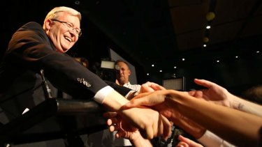 Kevin Rudd shakes hands with supporters as he concedes defeat.