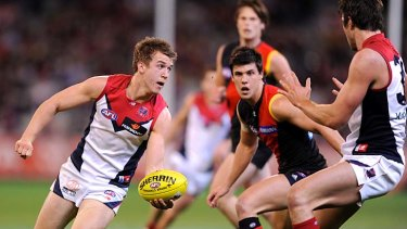 On a mission: Melbourne's Jack Trengove fires out a handball during last night's win against Essendon at the MCG.