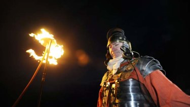 Beacons of light ... as night descended across northern Britain on Saturday, up to 500 volunteers, some dressed as Roman soldiers hold flaming torches to light up Hadrian's Wall.