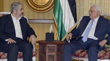 United approach: Hamas leader Khaled Meshal (left) with Mahmoud Abbas in Qatar on Sunday.