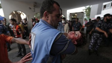 A girl injured in an Israeli strike in Shujaiyah, Gaza, outside a hospital.