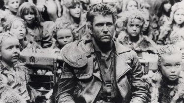 Mel Gibson surrounded by child actors in <i>Mad Max: Beyond Thunderdome.</i>