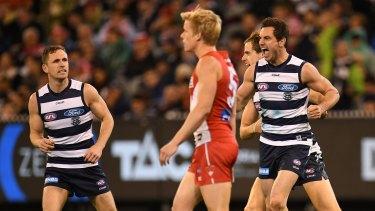 Happy returns: Daniel Menzel celebrates a major score as Geelong captain Joel Selwood (left) looks on.
