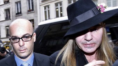 Facing six months' jail ... John Galliano (right), pictured with his lawyer.