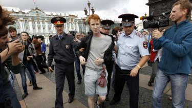 Police detain a gay rights activist Kirill Kalugin during his one-man protest in St. Petersburg.