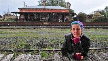 Local resident Belinda Michael at the disused Talbot train station and the landmark building of yesteryear.
