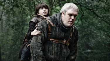 Kristian Nairn (right) as Hodor in Game of Thrones.