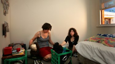 Student squatters pack up their belongings.