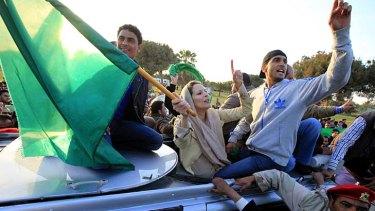 Backing her father ... Aisha Gaddafi waves a Libyan flag.