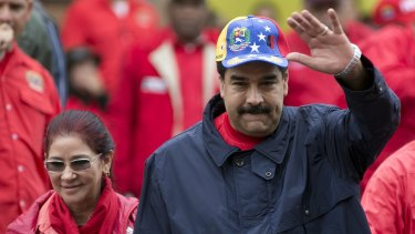 Venezuela's President Nicolas Maduro waves to supporters during a labor day march in Caracas.