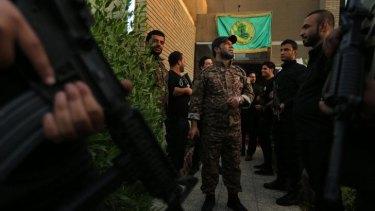 Don't call them militias: Haji Jaafar al-Bindawi (centre) with his men at the Imam Ali Brigade's headquarters in Baghdad.