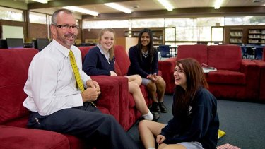 Classy approach: Templestowe principal Peter Hutton in the resource centre with Sarah Fraser (left), Semira Vandayar and Kyra Mallia (front).