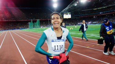 Magical time: Cathy Freeman wins gold medal in the women's 400 metres.