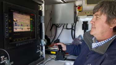 Systems engineer Jim Staggs operates the Active Denial System at a media demonstration.