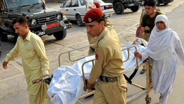 Pakistani soldiers carry injured Malala Yousafzai, 14.