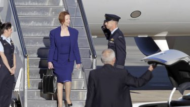 Prime Minister Julia Gillard arrives at Canberra airport yesterday. Ms Gillard attended the G20 summit in Mexico and Rio+20 forum in Brazil.