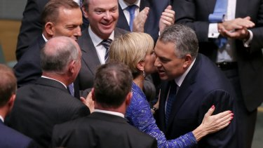 """Business has praised a """"softer, cuddlier budget"""" from Treasurer Joe Hockey, seen here congratulated by Foreign Affairs Minister Julie Bishop after handing down the Budget."""