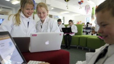 Work is play ... Jess Hawes, left, Isabella Fordy and Zachary Fenley collect points at Northern Beaches Christian School.