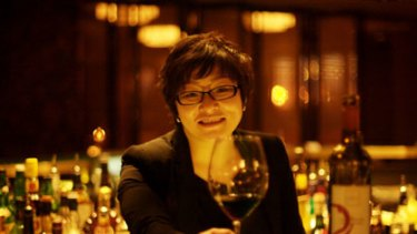 """They tend to like something full-bodied"" ... Beijing restaurant manager Nancy Wang samples a red."
