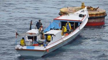 Perilous journey: The boat Luke Mogelson and Joel Van Houdt travelled on to Christmas Island.