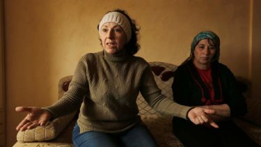 Gulnar Sefedina, left, sits with  Fatima Aliyeda, at a friend's home in Simferepol.
