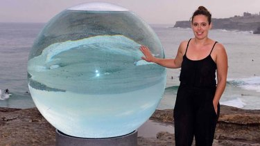 Talk of the town: Sydney artist Lucy Humphrey with her popular sculpture <i>Horizon</i>.