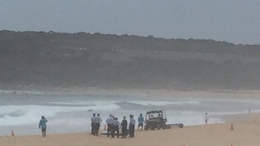 Police recover a body from the surf at Maroubra Beach on Friday.