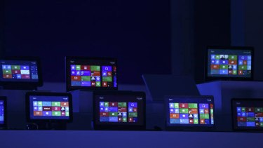 The Windows 8 software homepage is displayed on tablet devices at the Microsoft Windows 8 software consumer preview event at the Mobile World Congress in Barcelona in February, 2012.