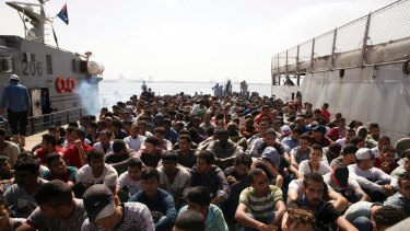 Migrants are detained in Tripoli, Libya.