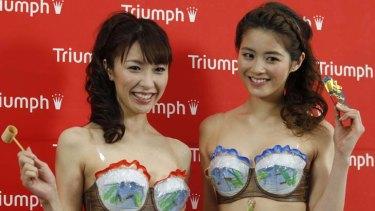Models present lingerie maker Triumph's new concept bra, the 'Super Cool Bra'.