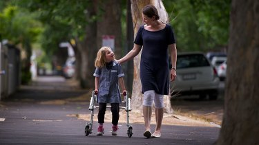 Jakki McKenzie and daughter Reese, who is disabled and not guaranteed a spot on the school bus next year.
