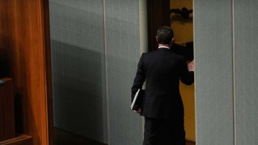Mustn't call the Prime Minister ''hopeless'' ... Christopher Pyne leaves the chamber after being ejected by the Speaker.