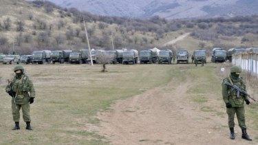 Soldiers block access to a Ukrainian border guard base near Simferopol.