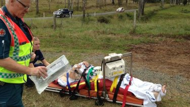 Paramadics prepare to airlift an International Rally of Queensland competitor to hospital.