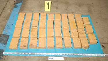 Three men allegedly used a wooden altar to smuggle heroin into Brisbane.
