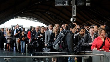 Passengers queue at 'Frankenbarriers' at Southern Cross station.