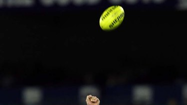 Out of reach: Kurt Tippett of the Crow and the Saints' Ben McEvoy compete for a mark.