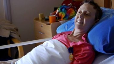 Connie proudly wears her Medal of the Order of Australia in her hospice bed in Canberra.