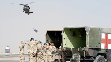 Evacuation ... medics prepare to receive patients from coalition medical helicopters at Kandahar.