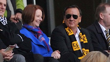 Fans ... Julia Gillard, with partner Tim Mathieson, at an AFL game earlier this year. She is yet to declare tickets to the grand final.