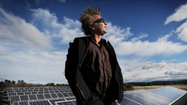 ACT Manager of SREC, Eddie Mior,  stands on top of the roof of the Kamberra Winery Building in Mitchell that has 800 solar panels.