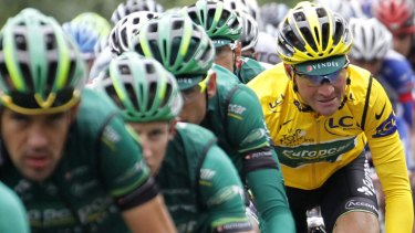 Vanguard ... yellow jersey holder Thomas Voeckler of France rides behind his Europcar teammates in the main pack during the 13th stage of the Tour de France, which was won by Norway's Thor Hushovd.