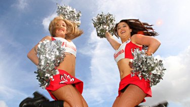Lifting the game ... Illawarra St George Dragons cheerleaders Lauren Chikitch and Alex McKeon.