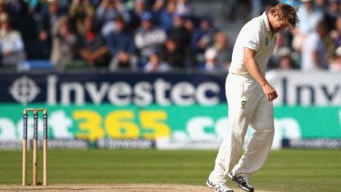 Blow for Australia: Shane Watson picks up an injury while bowling.