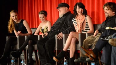 Dreams come true: George R. R. Martin, centre, shares a laugh with <i>Game of Thrones</i> stars Sophie Turner (left), Maisie Williams, Lena Headley and Peter Dinklage.
