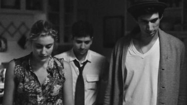 Greta Gerwig with slacker boys in a scene from <i>Frances Ha</i>.